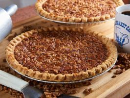 """Pecan Pie : <p>Three words: pie happy hour. Pecan pie is Texas' official state dessert, and one of the very best places and times to score a slice is from 3 to 5 p.m. at <a adhocenable=""""false"""" href=""""/content/food/restaurants/tx/marble-falls/b/blue-bonnet-cafe-restaurant.html"""">Blue Bonnet Cafe</a> in Marble Falls. The 70-year-old cafe is a family affair that serves as both a gathering place for locals and a pit stop for drivers taking the 281 shortcut from Dallas to San Antonio. Lyndon…"""