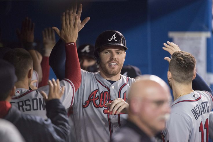 Caption: May 16, 2017; Toronto, Ontario, CAN; Atlanta Braves first baseman Freddie Freeman (5) celebrates scoring a run in the ninth inning during a game against the Toronto Blue Jays at Rogers Centre. Mandatory Credit: Nick Turchiaro-USA TODAY Sports
