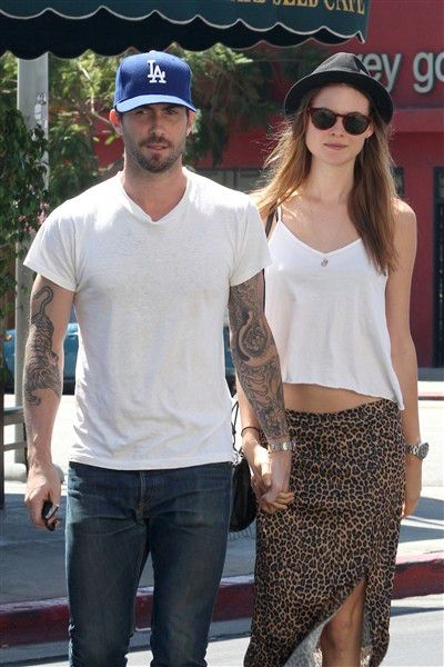 Hand holders! Adam Levine and Behati Prinsloo walked hand in hand on their way to lunch in Los Angeles on Sept. 7, 2012. We hope they let go to eat ...