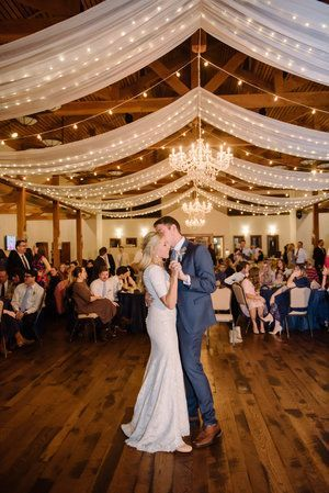 String lights and drapes make this wedding reception venue (and this bride and groom's first dance) a lot more magical. | This Is The Place Heritage Park - Salt Lake City, UT