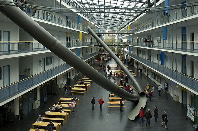 This is the Technische Universitat in Munich, Germany. Those giant tubes are slides to go from the top floor to the ground level patio. Why? It doesn't matter. This is an example to be followed all around the world.