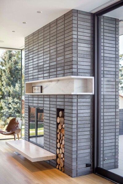 Grey brick mid cent fireplace | marble inset