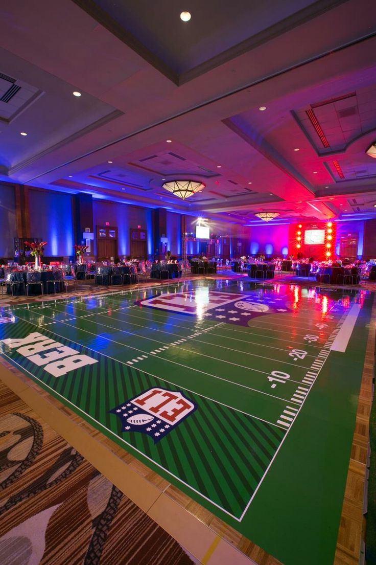 Bar mitzvah football dance floor by M&M Special Events in Dallas and Chicago #football #dancefloor #mitzvah www.mmspecialevents.com