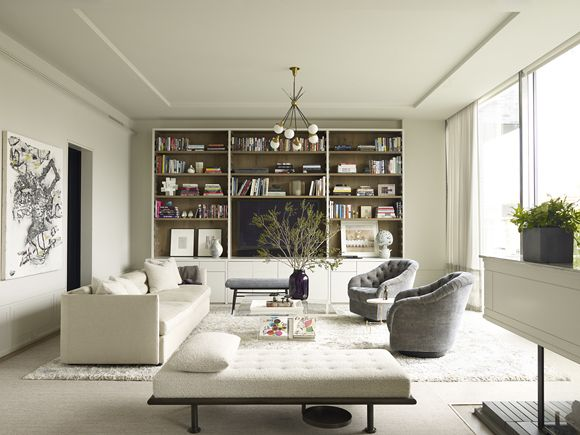 """According to Shawn Henderson, the wrong shade of white """"can feel more sterile than serene,"""" so the designer carefully selected the soft parchment hue of this downtown Manhattan apartment. The tufted swivel chairs are by Ward Bennett (from Lobel Modern) and the sofa is a custom piece by Henderson."""
