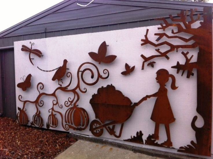 Children's playground at a Melbourne primary school. Laser cut metal wall art, rusted textural finish with a wall-mounted playful twist
