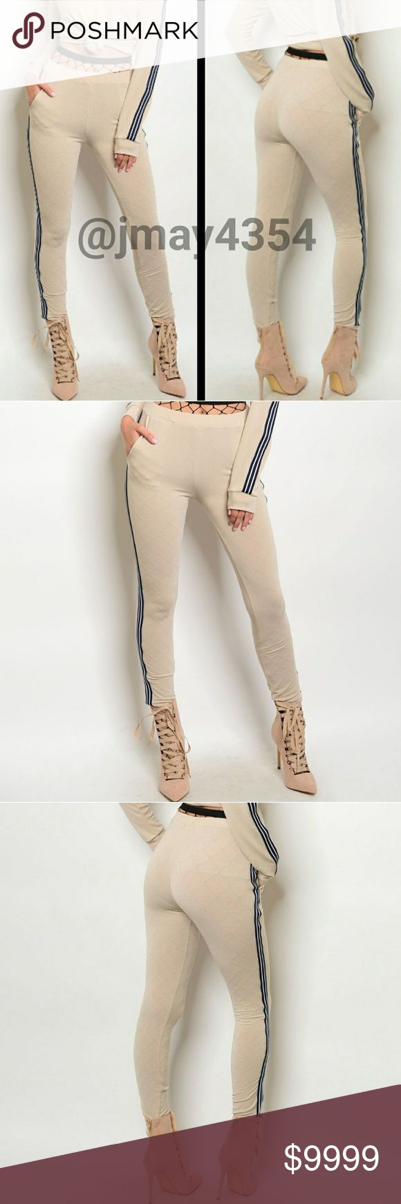 COMING SOON LOVE this! Tan with navy side lines skinny track pants. Matching sweater will also be available for sale. More details to come!  SIZE AVAILABLE: S M L MODELING SIZE:  I.G: @JMAYORGA91   LIKE TO BE NOTIFIED OR COMMENT BELOW Pants Track Pants & Joggers
