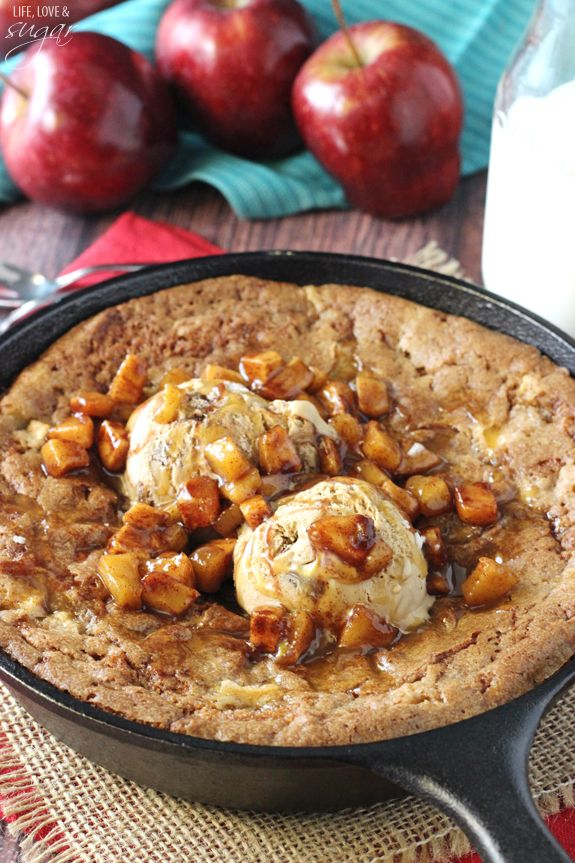 This Apple Cinnamon Skillet Blondie is a spiced blondie filled with apples, baked and warm, topped with ice cream and more cinnamon apples.