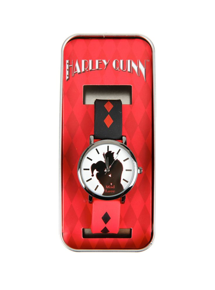 """Harley Quinn always makes time for a kiss with her Puddin'. Keep your watch game strong with this wristwatch from DC Comics. It has rubber bands that are inspired by Harley Quinn's jester outfit and a face design with a silhouetted Harley and Joker kissing and """"Mad Love"""" text design. Comes in metal display tin.       Alloy; rubber    Imported"""