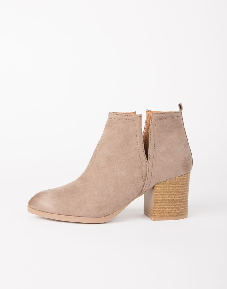 Booties, booties, booties rockin' everywhere. These Western-inspired Side Slit Suede Booties are made from a faux suede material. Features a pointy toe construction, oil finish distressed details, sid