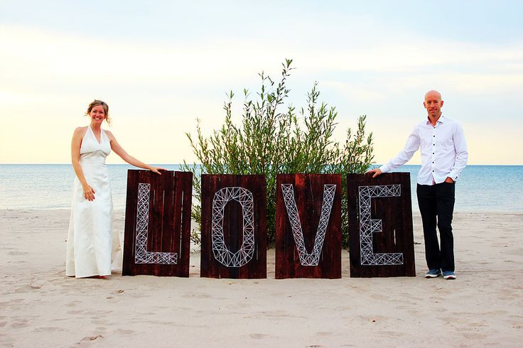 LOVE Wedding Sign, marquee style sign with string art.  Stunning huge wedding prop.  You can find this and other amazing props @LittleWeePropShop.  #VintageProps #WeddingRentals, #Wedding #BeachWedding