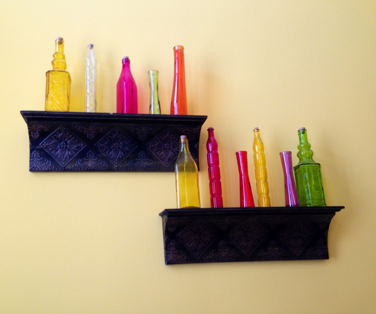 I used cheap colored glass bottles on tin shelves for wall for Colored bottles for decorations