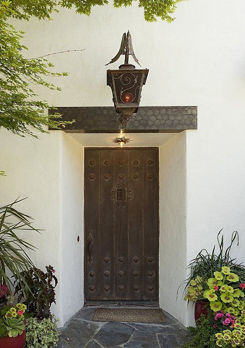 Spanish Entry: Change out the door, add light fixture, stone entry pad and a mix of colorful plants