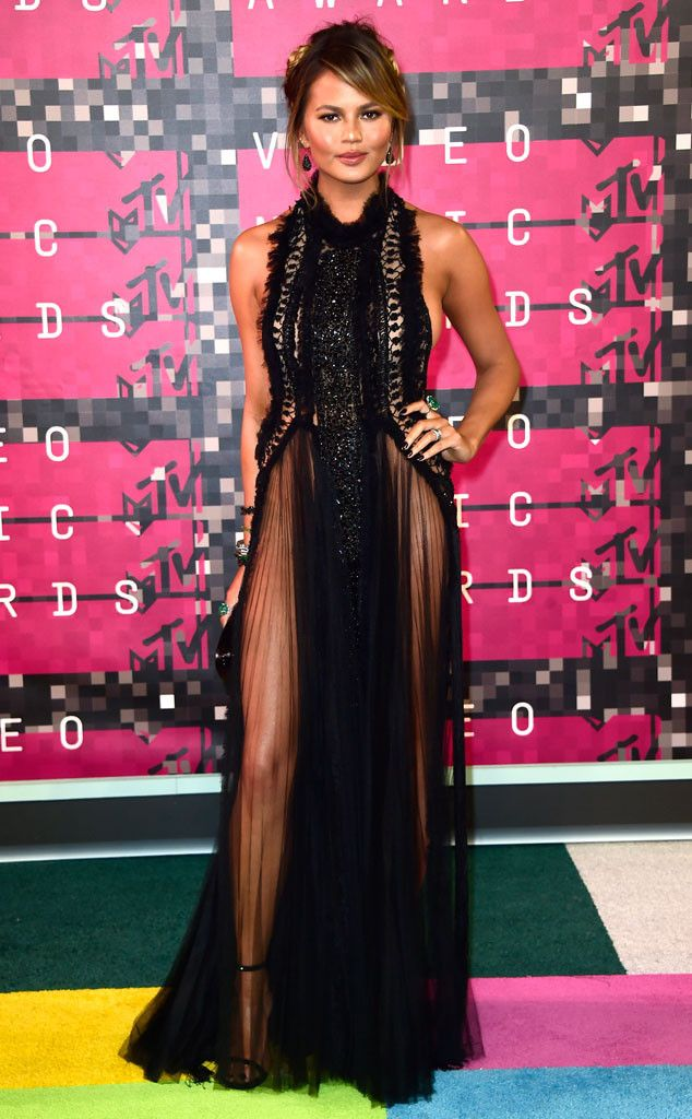 Chrissy Teigen from 2015 MTV Video Music Awards Red Carpet Arrivals  Crushing it! John Legend's wife nails it in this super-sheer black gown.