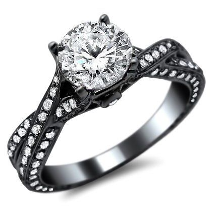 Round Diamond Pave Engagement Ring 14K in Black Gold - This new certified 1.78ct diamond engagement ring is set in 14k black gold with an excellent cut SI-1 clarity .71ct round diamond set atop of the ring. It features 1.07cts of lovely white round diamonds that surrounds the solitaire. They are set graduating down the sides & outsides of the ring covering 80% of it. The ring's top measures 5.7mm wide along the finger at its largest point. #unusualengagementrings