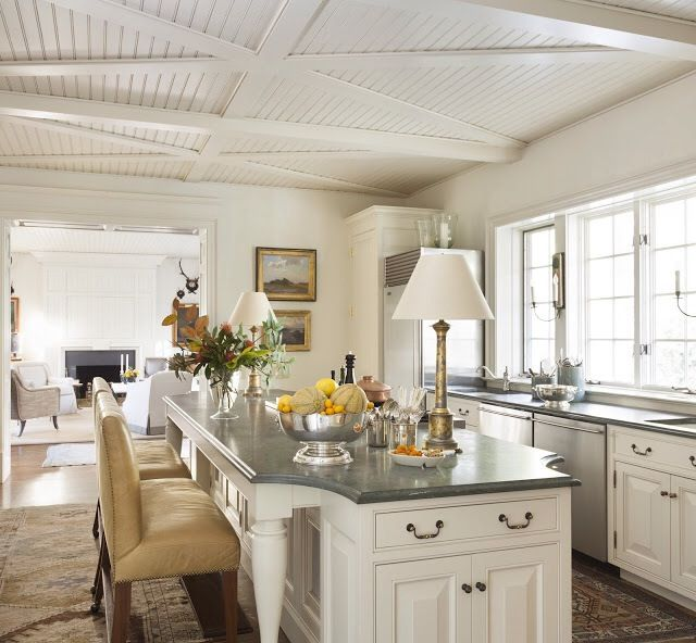 Stunning!  This beadboard ceiling has been made more interesting by the addition of the X beams.