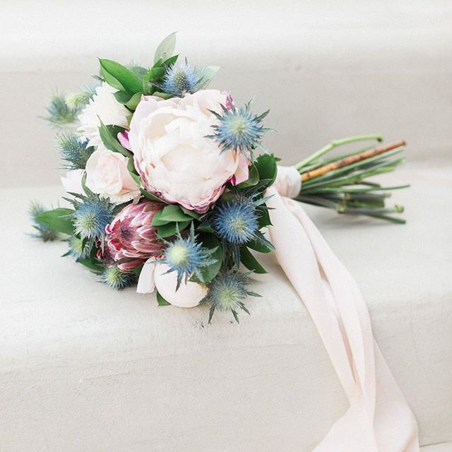 We still cant get over how beautiful this bridal bouquet we made looks // and this is only our beginning 🌸 Photo @sandyandodysseas . . . #bridalbouquet #santoriniglamweddings #weddingfloral #weddingflowers #mykonoswedding #weddingdetail #weddingingreece #destinationweddingplanner #destinationflorist #destinationwedding