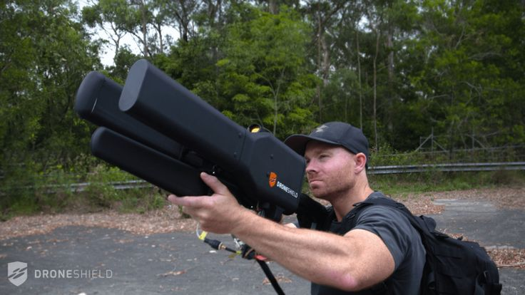 Dronegun, A Device for Taking Control of Rogue Drones and Safely Landing Them