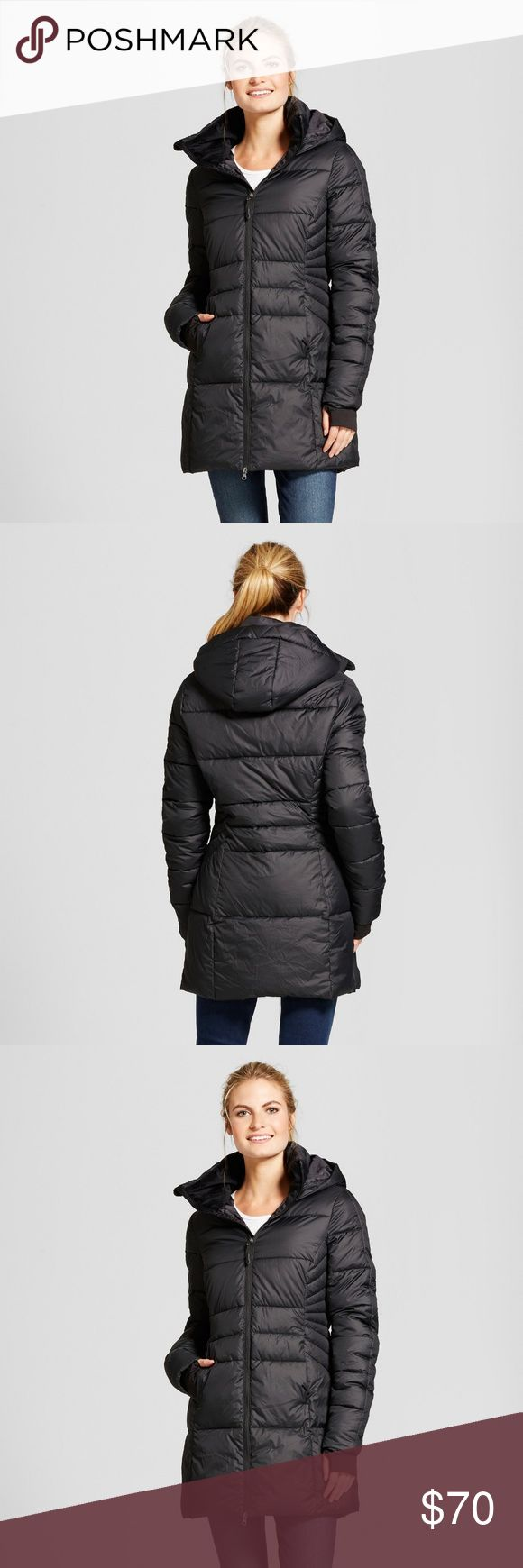 Women's Puffer Coat Black XL With an asymmetrical zip, this winter coat features compressible lightweight insulation that keeps you warm and active. Size XL Color: Black Jackets & Coats