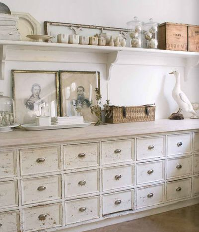 Entrance way chest of drawers and shelf arrangement.
