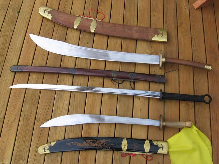 The bottom sword is an Ox Tail Dao (broadsword) one handed  Middle Sword is a Miao Dao (Willow Leaf Saber) pride and joy of the collection a clay hardened HRC 1095  Top sword is a two handed Ox Tail Dao, heavy at 10 kilograms