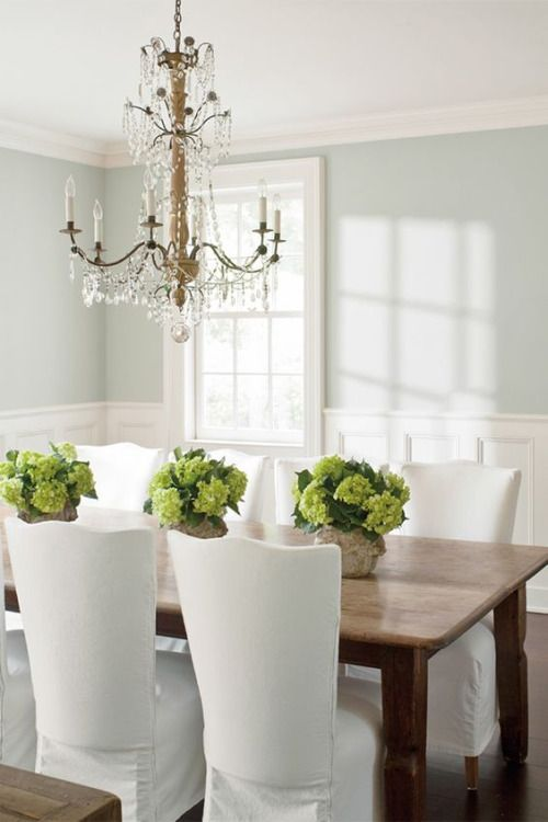 LOVE this chandelier!! It's a perfect contrast to the simplicity of the table & slip-covered chairs.