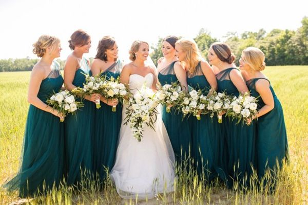 deep teal bridesmaid dresses - photo by Courtney Dox Photography http://ruffledblog.com/romantic-southern-wedding-in-south-carolina