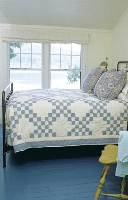 """Love the Double Irish Chain quilt in this """"Bluetiful"""" primitive bedroom. Love the painted floor also and yellow chair."""