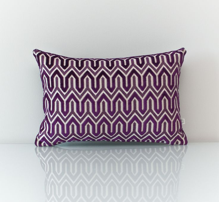 Purple pillow available at threadsandmore.ca An opulent purple pillow that uses a combination of viscose, polyester and cotton to provide multiple textures. Nothing looks more luxurious than a velvet accent in a deep purple shade - it's a match made in heaven. FREE customization available