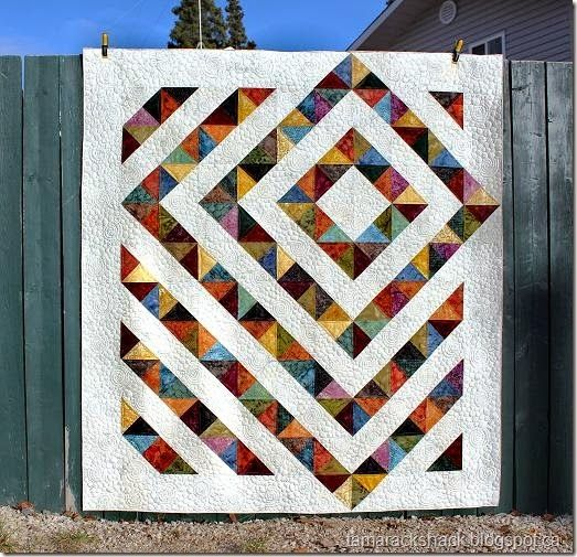 Four Patch Charm Quilt with Tutorial by Kathy at tamarackshack.blogspot - like how it goes into the borders