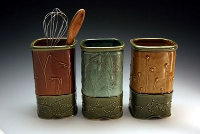 Christy Knox - handmade stoneware vessels, impressed with images of leaves and blossoms and other found objects, variety of high temperature glazes used.