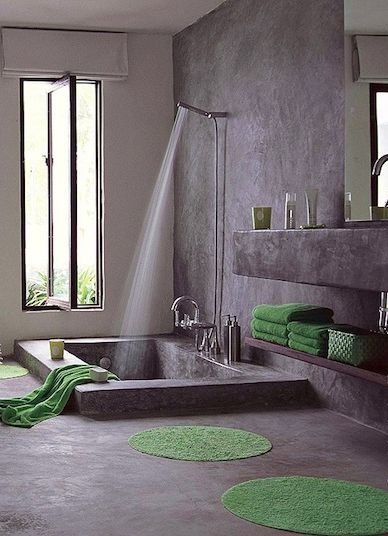 Complete with an in-ground concrete bath, this Italian bath has a cave-like spa feel. Great look for outdoor shower/bath.