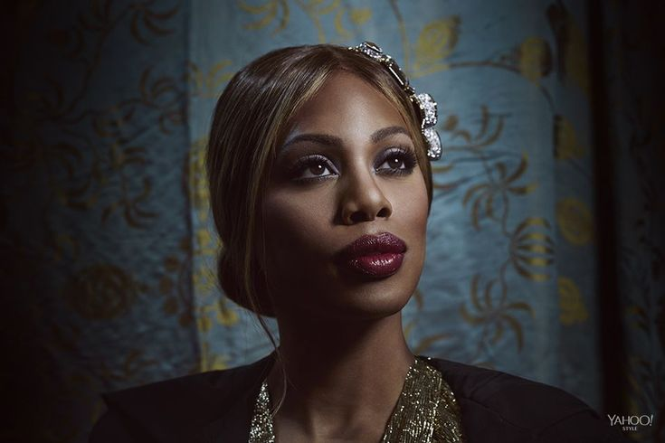 Laverne Cox wears a gold gown by Lanvin and Swarovski Dilemma Necklace.  Photography by Finlay Mackay for Yahoo Style
