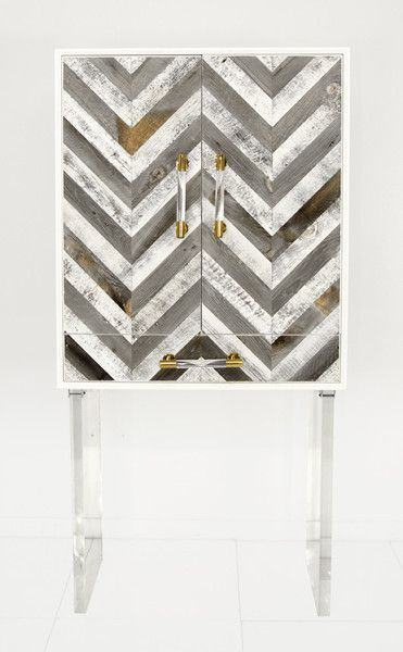 Our stylish Capri bar cabinet is perfect for entertaining. This multi-use bar cabinet sits on top of gloss white box which frames and features our Chevron stripes on Recycled Wood. The Bar stands on t