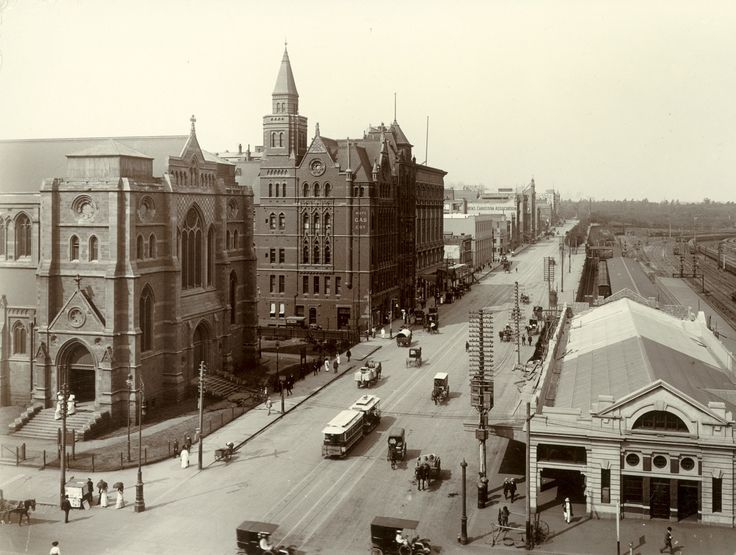 Looking up Flinders Street from Swanston Street (1914) with St Paul's Cathedral on the left and Princes Bridge Station on the right. Melbourne Australia