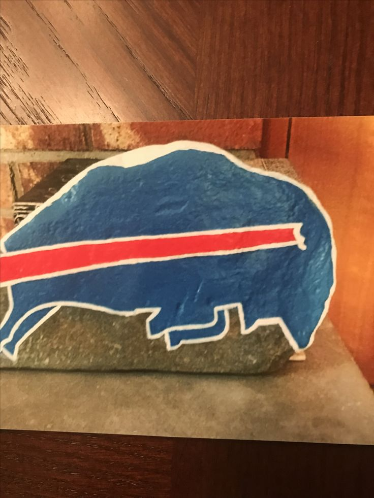 Flat rock painted with blue buffalo for Buffalo Bills football