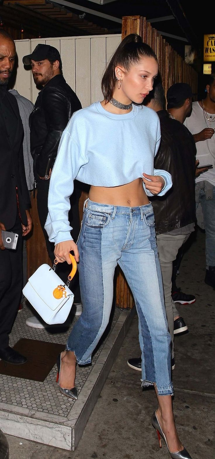 Bella Hadid in Danielle Guizio top, Fallon necklace, Dior bag, Frame Denim jeans, and Christian Louboutin shoes.