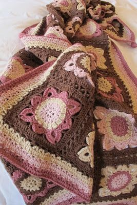 (I printed the pattern from the link that shows the blanket in blues and white. I like the pinks and browns better.)