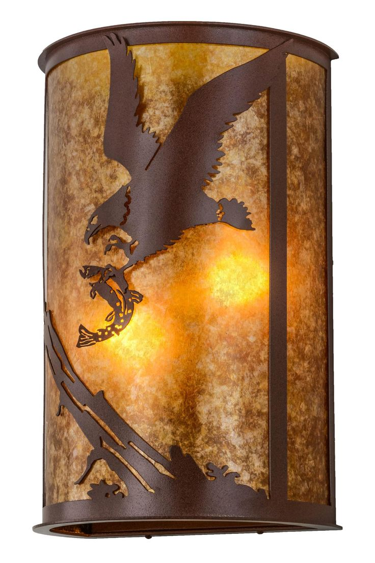 13 Inch W Strike Of The Eagle Wall Sconce - 13 Inch W Strike Of The Eagle Wall SconceAn iconic bird of prey and national symbol, themajestic Eagle performs a death-defying swoop whilepreparing to snatch its prey with massive sharp talons.This rustic lighting fixture is featured with a stunning, curved Amber Mica lens and hardware and decorative accents in an Rust finish. The wall sconceis custom crafted in the USA at the foothills of New York's glorious Adirondack Mountains. Custom…