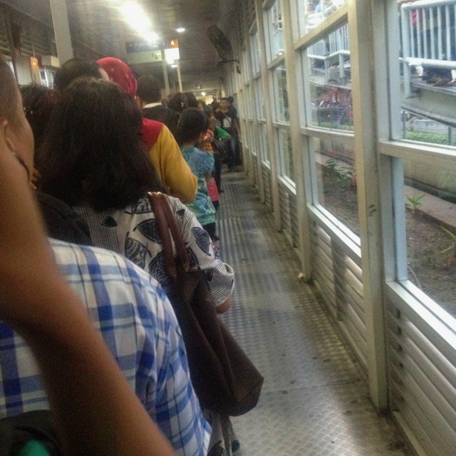 Queuing at Trans Jakarta's bus shelter.