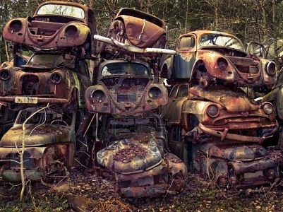 Stacks of old cars (Volkswagon bugs)  oh what a shame poor vw's