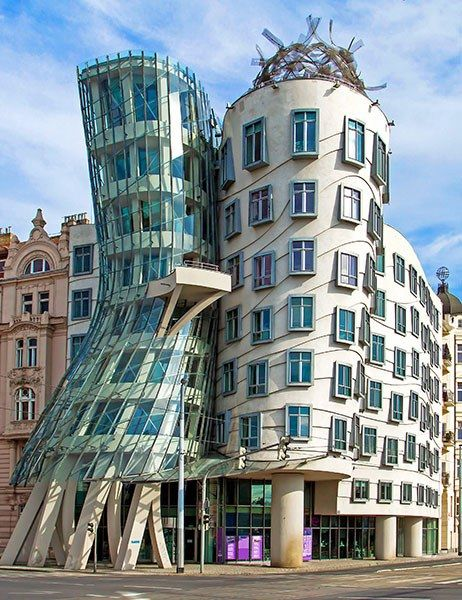 The Prague offices of the Dutch insurance company Nationale-Nederlanden is also known as Fred and Ginger, thanks to its signature pair of towers, which seem to resemble a couple dancing. The 1996 building, comprising a cinched volume of metal mesh and glass and a concrete cylinder, was a collaboration between Gehry and local architect Vlado Miluníc.