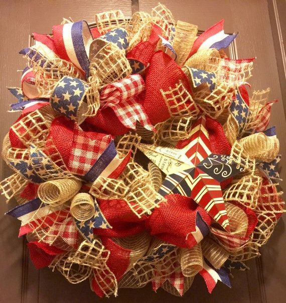 This patriotic wreath is perfectly handmade for all burlap lovers. Its made on a wire wreath frame from jute deco mesh, red burlap, jute mesh ribbon & 3 different styles of patriotic wired burlap ribbon. It is adorned with a multi burlap ribbon bow and a patriotic metal star. It measures approximately 27 in diameter and is READY TO SHIP. It can be displayed during the 4th of July holiday season or all year round.
