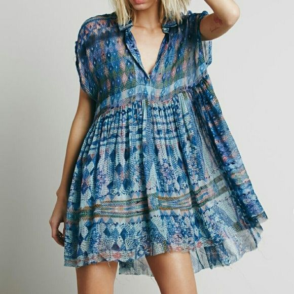 Free People Empire Extreme Shirt Dress Beautiful blue flowey Free People Dress in Marine Combo.   NWOT and In great condition. No rips, tears, holes or stains. Free People Dresses Mini