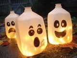 Halloween DecorationsHalloween Decorations, Glow Sticks, Cute Ideas, Ghosts, Christmas Lights, Halloween Crafts, Milk Cartons, Milk Jugs, Halloween Ideas