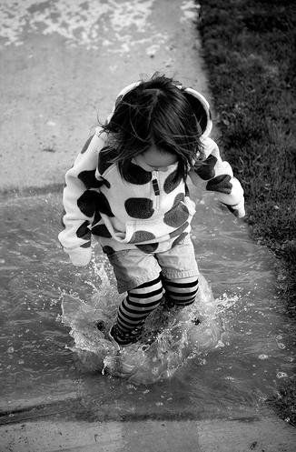 splashing in the puddles  http://thewriteonproject.wordpress.com/2011/02/02/getting-wet/splashing-in-the-puddles/