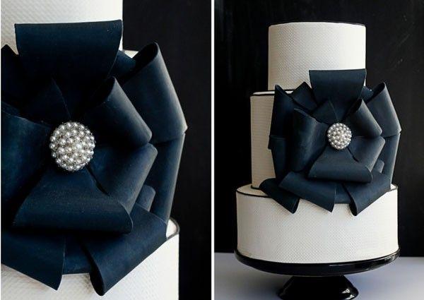 white wedding cake with large black bow