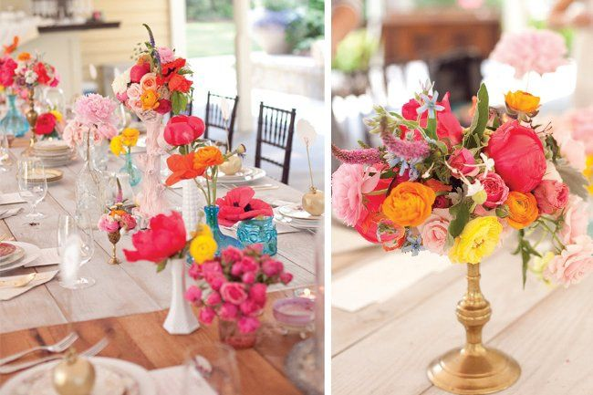gorgeous tabletop setting with flowers in pink, yellow and orange