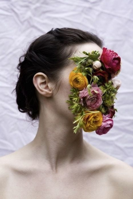 i think that this juxtapositioning of the flowers on the face works really work and makes me think of how humans could evolve to look and how in 20 years or so will we look completely different and function completely different.