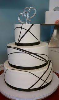 Ribbon Wedding Cake/This would look cool with turquoise stripes instead of black. And the topper is ugly