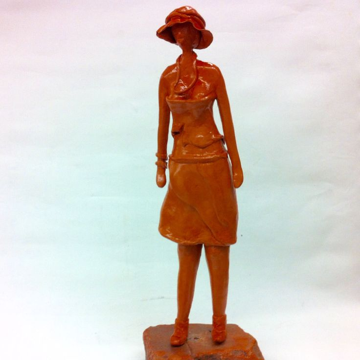 Girl with hat. Clay sculpture.